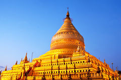 Shwezigon Pagoda at sunrise in Bagan Archaeological zone, Myanma Stock Photo