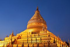 Shwezigon Pagoda at twilight in Bagan, Myanmar Stock Photography