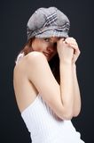 Shy...02. Sensual girl in white, with hat , posing on black background stock photos