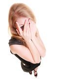 Shy afraid woman peeking through fingers isolated. Royalty Free Stock Photography