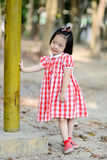 Shy Asian girl in the park outdoor. Royalty Free Stock Photo