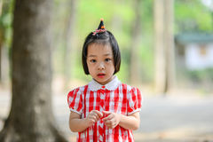 Shy Asian girl in the park outdoor. Royalty Free Stock Image