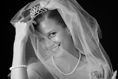 Shy beautiful bride. Hiding behind her veil Royalty Free Stock Photo