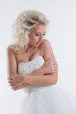 Shy beautiful bride posing in studio, close-up Royalty Free Stock Image