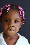 Shy black girl. Here is a beautiful picture of a shy young black girl nervous in front of the camera Royalty Free Stock Photos