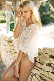 Shy blond woman in the tropical resort Stock Photography