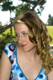 Shy blonde. In a blue Polka dot dress Royalty Free Stock Photo