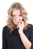 Shy blonde woman in black Royalty Free Stock Photos