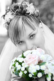 Shy bride with a flower bouquet Royalty Free Stock Photos