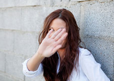 Shy brunette girl covering her face Stock Photography