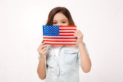 Shy child holding American symbolic in the studio Stock Photo