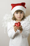 Shy Christmas Angel. Christmas Angel with red heart Stock Photography