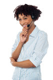 Shy customer support executive looking away Stock Images