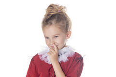 Shy cute teen girl isolated on a white background. Smirking funny kid. Stock Photos