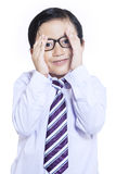 Shy expression of little businessman - isolated Royalty Free Stock Photo