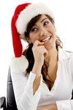 Shy female executive wearing christmas hat Stock Photography