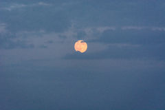 Shy full Moon. Full moon partially obscured by some clouds Royalty Free Stock Photography