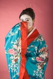 Shy Geisha in yukata. Asian female with geisha style face paint in yukata (kimono Stock Photo