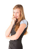 Shy girl. Young beautiful woman holding her finger in her mouth Royalty Free Stock Image