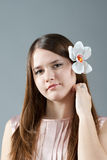 Shy girl. With flower in hair Royalty Free Stock Photo