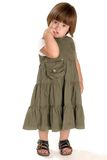 Shy girl. Adorable little girl, standing on a white background Stock Photos