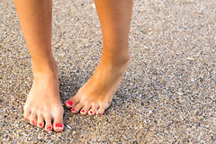 Shy Girl. Feet Standing In Sand royalty free stock photo