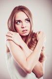 Shy girl, afraid woman on gray. Background stock photos