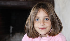 Shy girl with bob hair. Portrait of a caucasian shy child with bob hair Stock Photo
