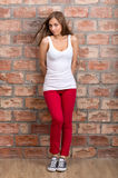 Shy girl casual design in red pants Stock Photography