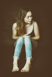 Shy girl in the corner cry royalty free stock image