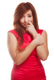Shy girl embarrassed woman in red dress pressed Royalty Free Stock Images