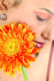 Shy girl with gerbera flower Stock Photo