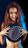 Shy girl hiding boobs behind a hat Royalty Free Stock Photo