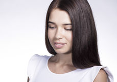 Shy girl. Intimidated young woman looking down Royalty Free Stock Images