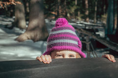 Shy girl looking out Royalty Free Stock Photography