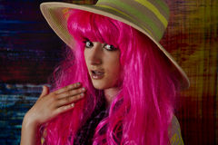 Shy girl with Pink hair and sun hat. Stock Photos