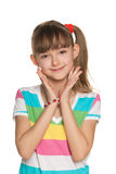 Shy girl in a striped blouse Royalty Free Stock Photos
