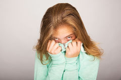 Shy girl. A shy teenage girl trying to hide her face stock images