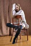 Shy girl in wool cardigan Royalty Free Stock Image