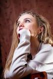 Shy girl in wool cardigan Stock Photos