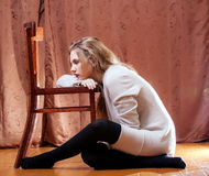 Shy girl in wool cardigan Stock Photography