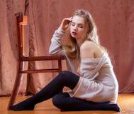 Shy girl in wool cardigan Stock Image