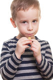 Shy guy. Shy boy with candy on isolated white Royalty Free Stock Photography