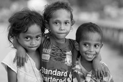 Shy Indonesian kids in Papua area Royalty Free Stock Images
