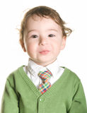 A shy little boy. A little boy poses. Isolated Royalty Free Stock Image
