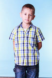 Shy little boy with hands behind back. Stock Images