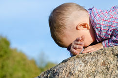 Shy little boy hiding has face Royalty Free Stock Photography