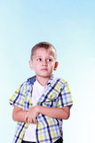 Shy little boy hold hands. Royalty Free Stock Photos
