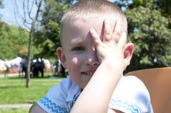 Shy little boy playing Stock Image