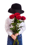 Shy little boy with red roses Stock Photography
